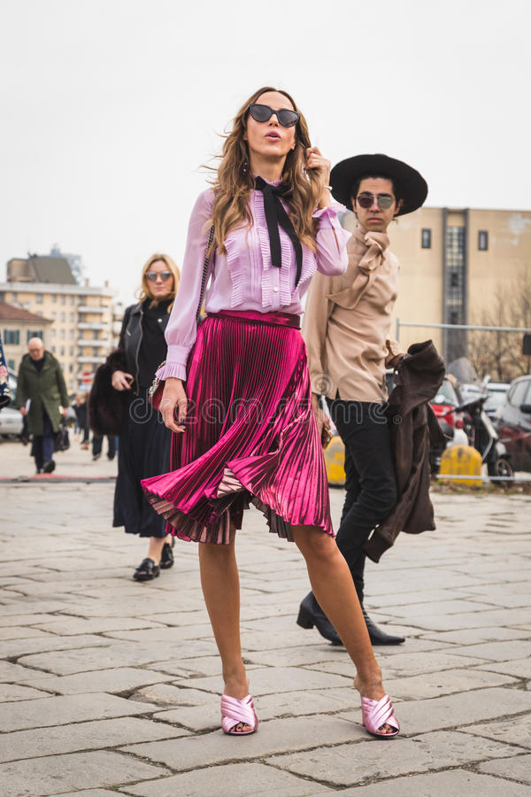 People outside Gucci fashion show building for Milan Women's Fashion Week. MILAN, ITALY - FEBRUARY 24: People gather outside Gucci fashion show building for stock images