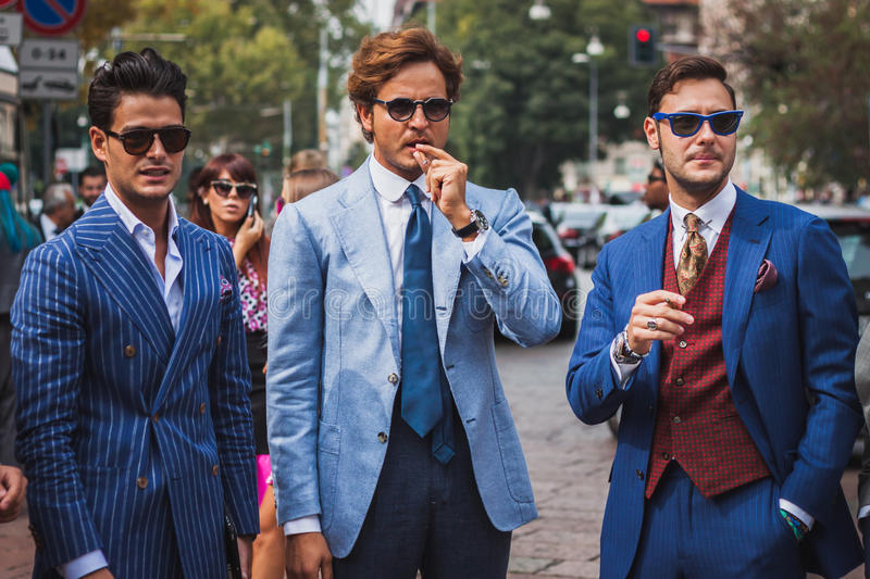 People outside Gucci fashion shows building for Milan Women's Fashion Week 2014 royalty free stock photo