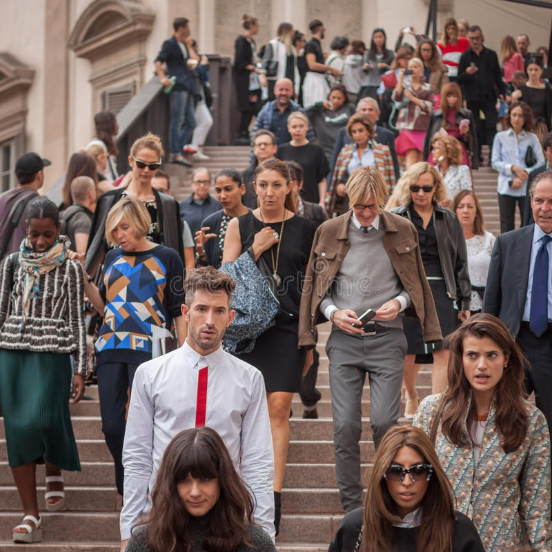 People outside Marco De Vincenzo fashion shows building for Milan Women's Fashion Week 2014 stock images