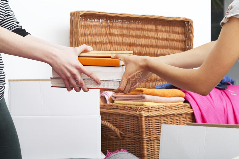 People Packing Books Royalty Free Stock Images
