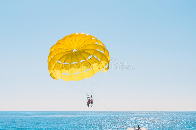 Parachute And Parasailing In Sky Stock Image - Image of