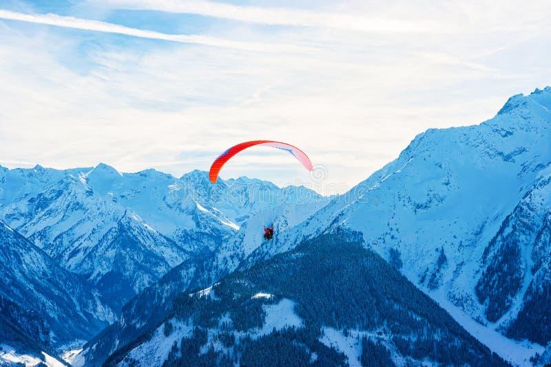 People paragliding on parachute in sky Penken Park Austria. People paragliding on parachute in sky. Alps mountains on Penken Park ski resort in Tyrol at stock image