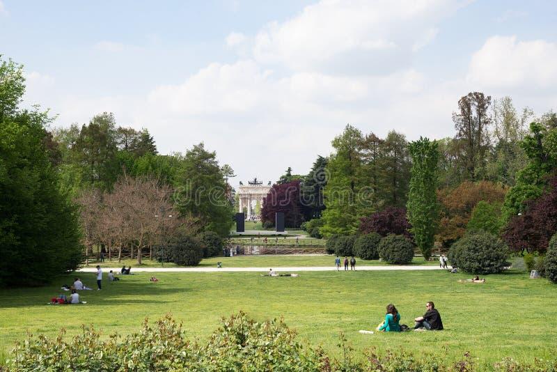 People in park public garden, Arco della Pac of Parco Sempione, Milan royalty free stock photo