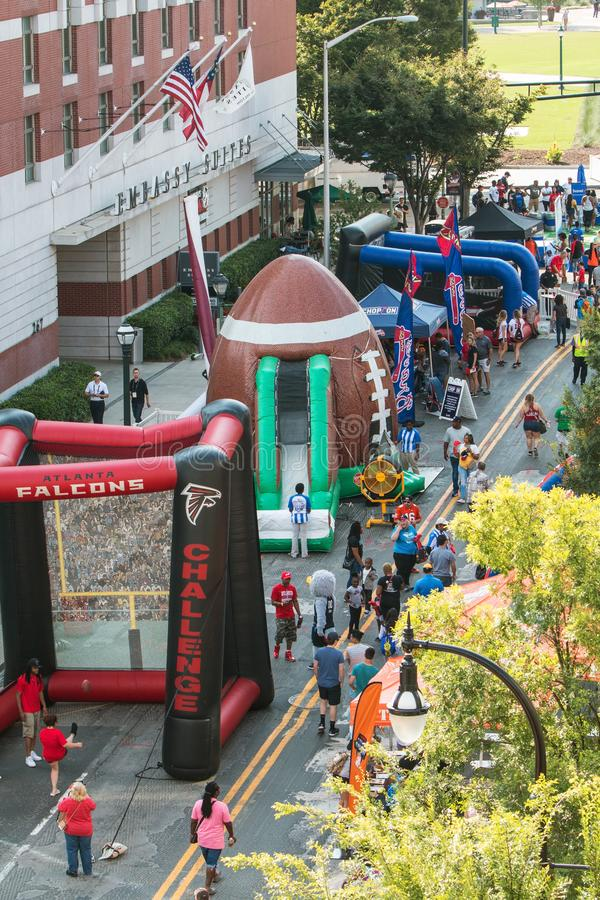People Participate In Inflatable Games At College Football Fan Fest stock images