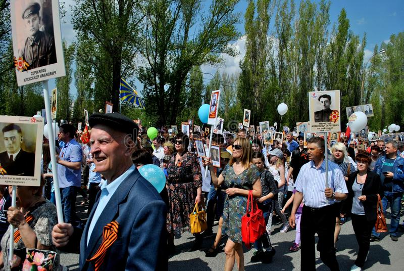 People participating in the Immortal Regiment action come with photos of their relatives. stock photography