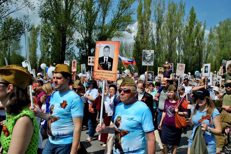 People participating in the Immortal Regiment action come with photos of their relatives. stock images
