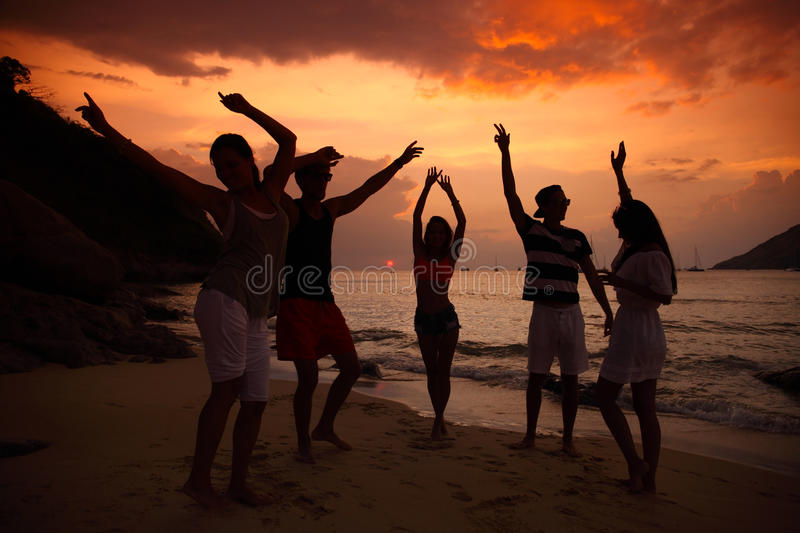 People partying on beach stock photography