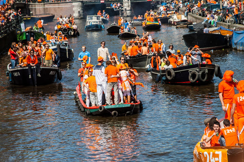 People partying on the canals - Koninginnedag 2012 stock image