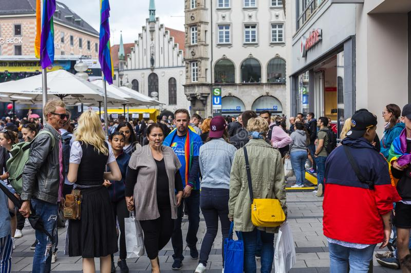 People partying at the Marienplatz at the Christopher Street Day CSD event in Munich, Germany. 2019: People partying at the Marienplatz at the Christopher royalty free stock image