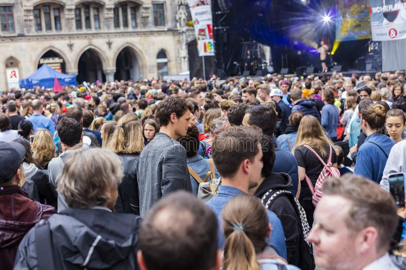 People partying at the Marienplatz at the Christopher Street Day CSD event in Munich, Germany. 2019: People partying at the Marienplatz at the Christopher royalty free stock photo