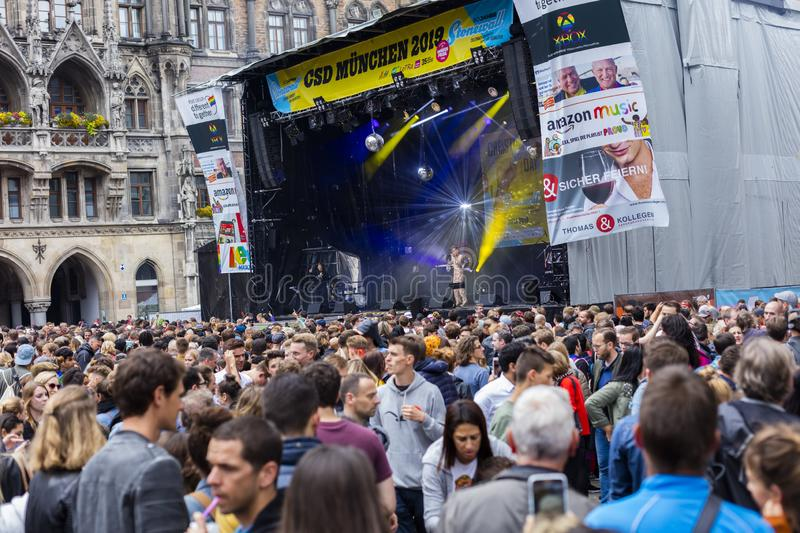 People partying at the Marienplatz at the Christopher Street Day CSD event in Munich, Germany. 2019: People partying at the Marienplatz at the Christopher royalty free stock images