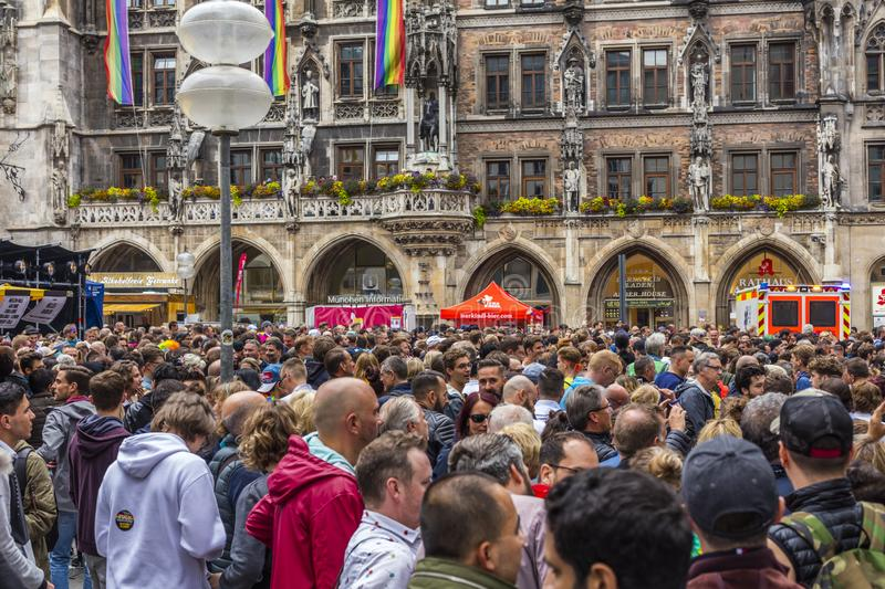 People partying at the Marienplatz at the Christopher Street Day CSD event in Munich, Germany. 2019: People partying at the Marienplatz at the Christopher royalty free stock photos