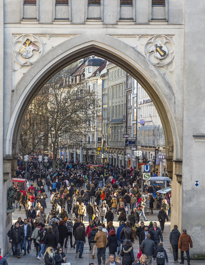 People pass the Karlstor at Stachus royalty free stock photography