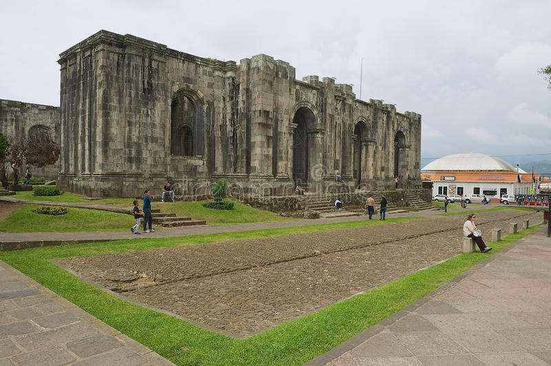 People pass the ruins of the Santiago Apostol cathedral in Cartago, Costa Rica. stock images