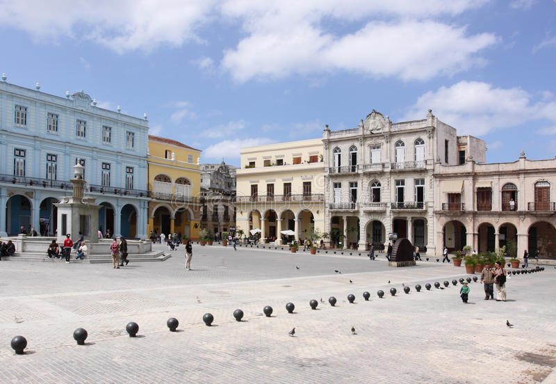 Download People Passing By In Plaza Vieja, Havana Editorial Stock Image - Image: 13671134