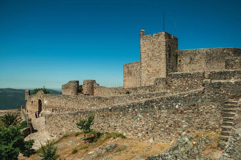 People on pathway next to stone wall of the Marvao Castle royalty free stock photo
