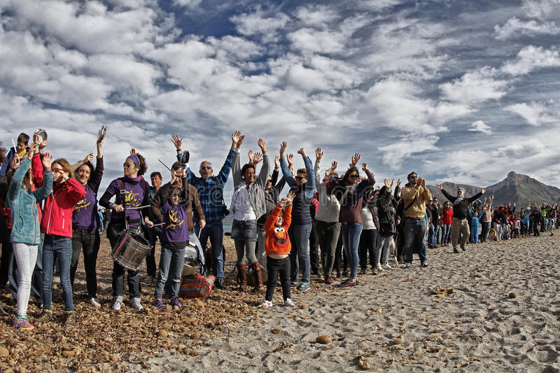 People in a peaceful demonstration on a beach to protect it from construction stock photos