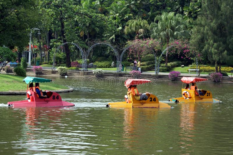 Download People Pedalling Boats On A Lake In Dusit Zoo, Bangkok, Thailand Editorial Image - Image of reflection, site: 68390780