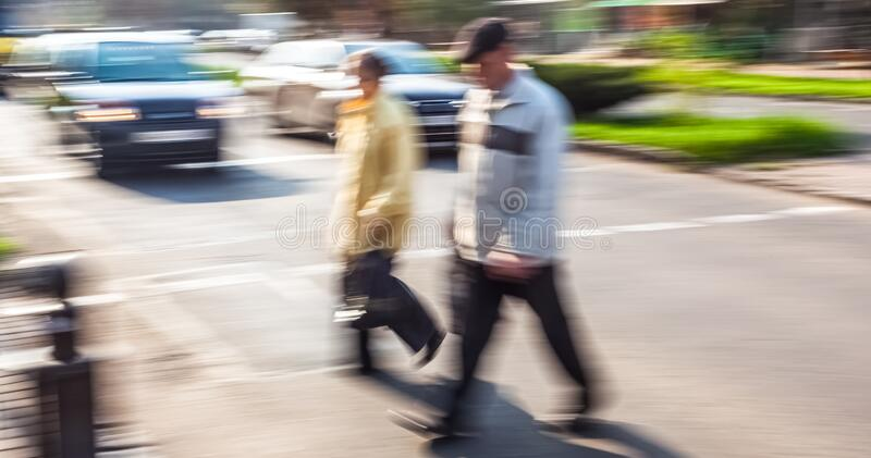 People at a pedestrian crossing stock photo