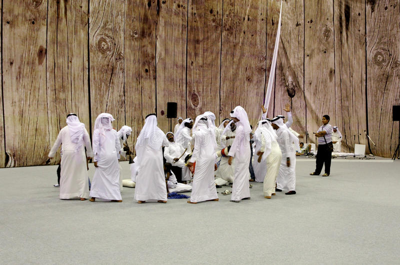 People performs folklore pearling songs. SANABIS, BAHRAIN - MAY 04: People performs folklore pearling songs with traditional musical instruments during 20th royalty free stock image