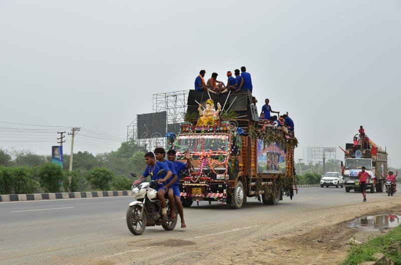 People perfroming Kanvar Yatra or Kavad Yatra (Hindi Words), it is annual pilgrimage of devotees of Shiva. Editorial: Gurgaon, India: JULY 31st, 2016: People stock image