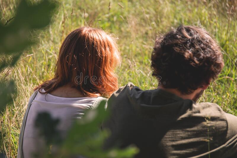 People Photography Of Man And Woman Sitting On Green Grass Field Free Public Domain Cc0 Image