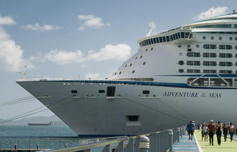 People on pier at Adventure of the Seas docked in Martinique stock images