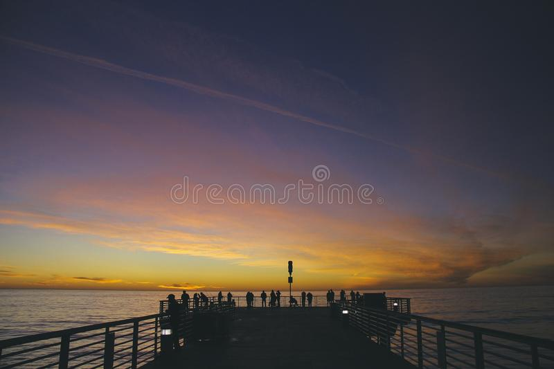 People On Pier At Sunset Free Public Domain Cc0 Image