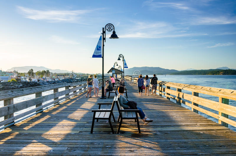 People on a Pier at Sunset royalty free stock images