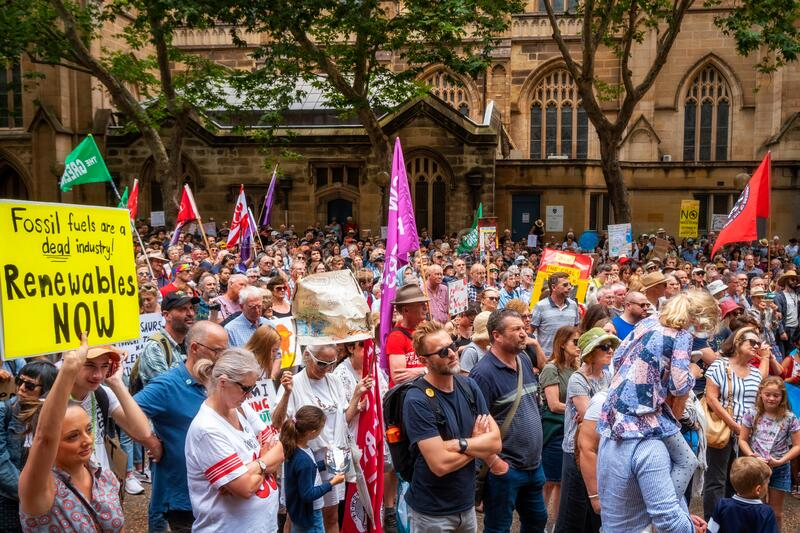 People with placards and flags at a climate change protest at Sydney Town Hall. royalty free stock photos
