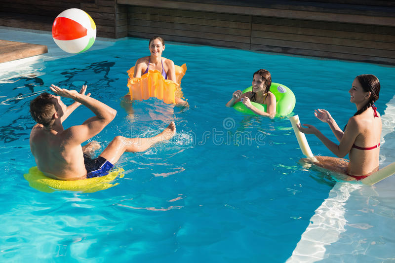 People playing with ball in swimming pool stock photo image of summert view 43656632 for Morris il public swimming pool