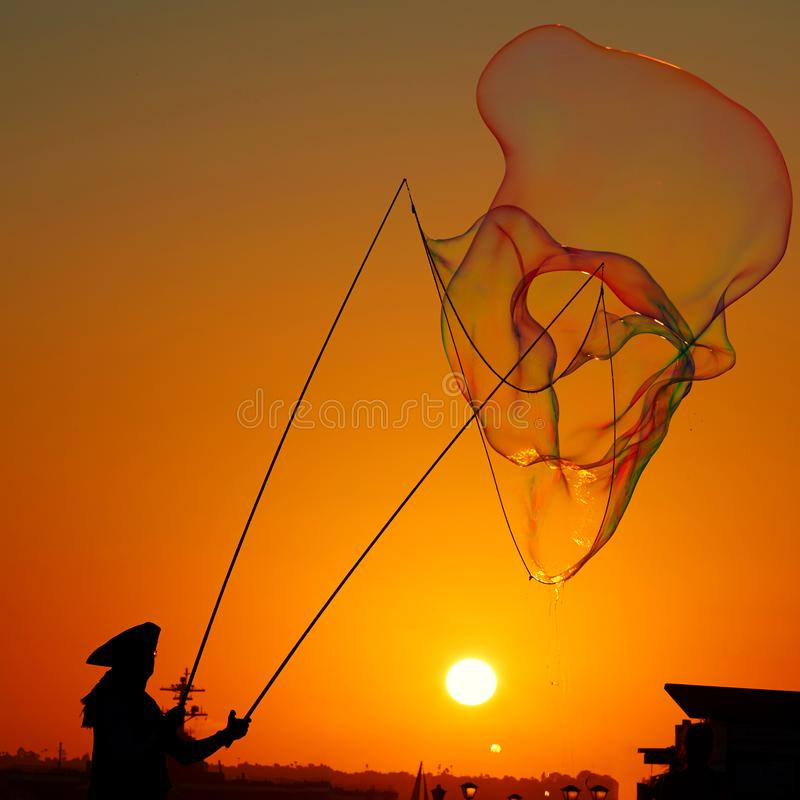 People playing bubbles, summer background stock image