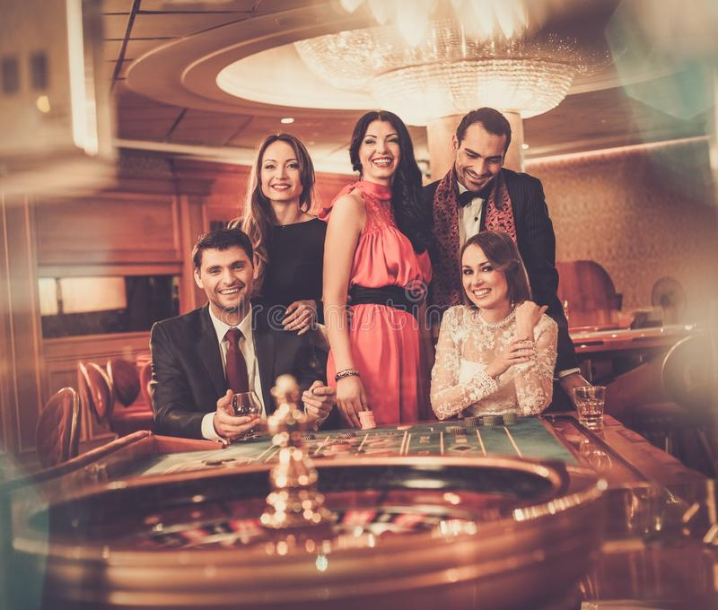 People playing in a casino stock photo