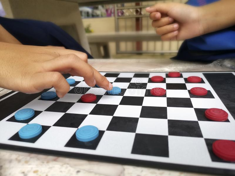 People are playing checkers close-up, the concept of a board game stock photo