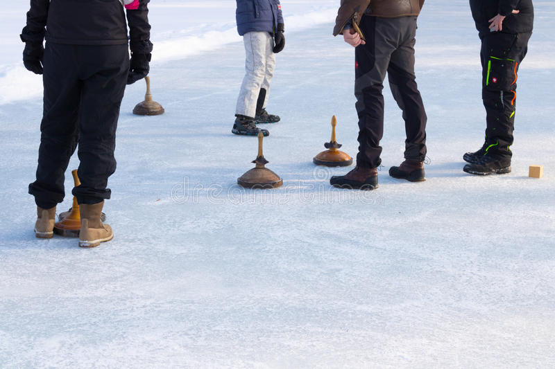 People playing curling on a frozen lake, Austria, Europe. Winter sport stock images
