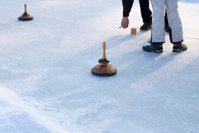 People playing curling on a frozen lake, Austria, Europe. Winter sport royalty free stock photo