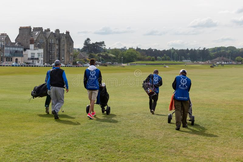 People playing golf at famous golf course St Andrews, Scotland stock photos