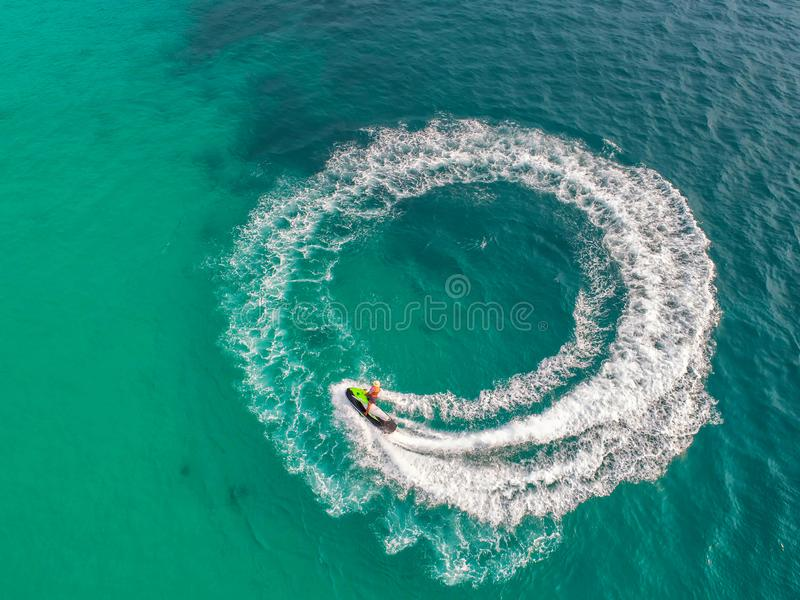 People are playing a jet ski in the sea.Aerial view. Top view.amazing nature background.The color of the water and beautifully br. Ight. Fresh freedom. Adventure royalty free stock photography