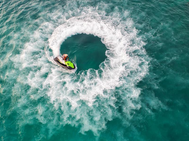 People are playing a jet ski in the sea.Aerial view. Top view.amazing nature background.The color of the water and beautifully br. Ight. Fresh freedom. Adventure royalty free stock photos