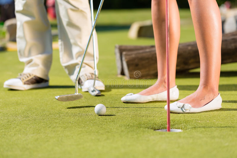 Download People Playing Miniature Golf Outdoors Stock Image - Image: 27368957