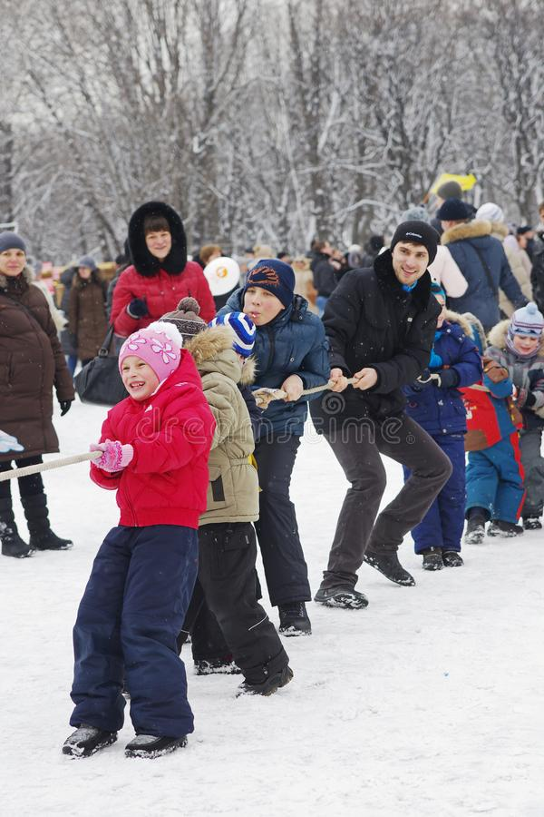 People playing Tug Of War at Russian national festival `Shrove` in park Gorkogo in Moscow stock photo
