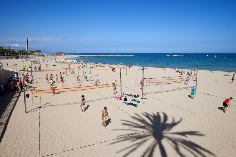 People Playing Volleyball on a Beach in Barcelona stock photos