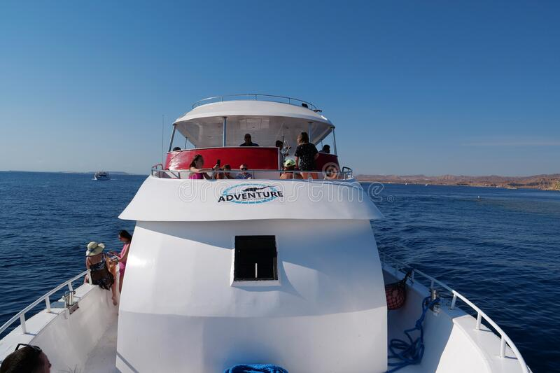 People on pleasure boat in the Red Sea near coast of Sharm El Sheikh city. EGYPT, SINAI, SHARM EL SHEIKH, DECEMBER 7, 2019: People on pleasure boat in the Red royalty free stock photography