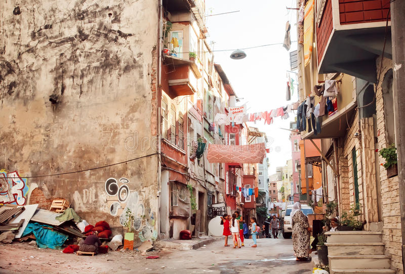 People on the poor street with old city buildings Turkey. stock image