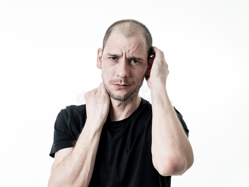 Close up portrait of sad young man face suffering from depression, stress and unhappiness royalty free stock photo