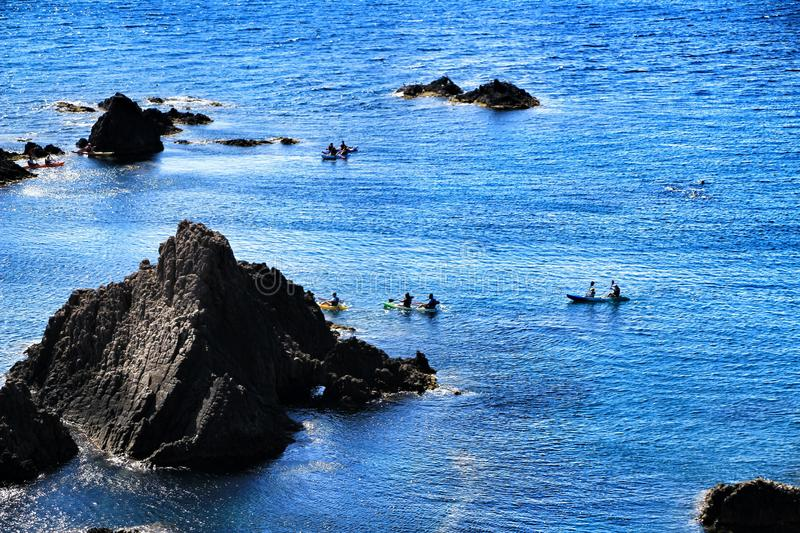 People practicing canoeing in the Reef of the Sirens. In Cabo de Gata, Almeria, Spain royalty free stock image