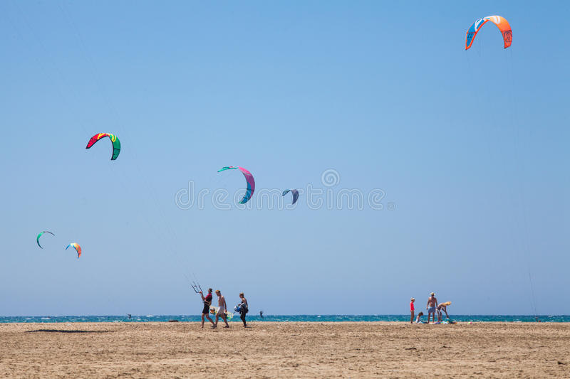 People practicing Kitesurfing. Beach on the Prasonisi. royalty free stock image