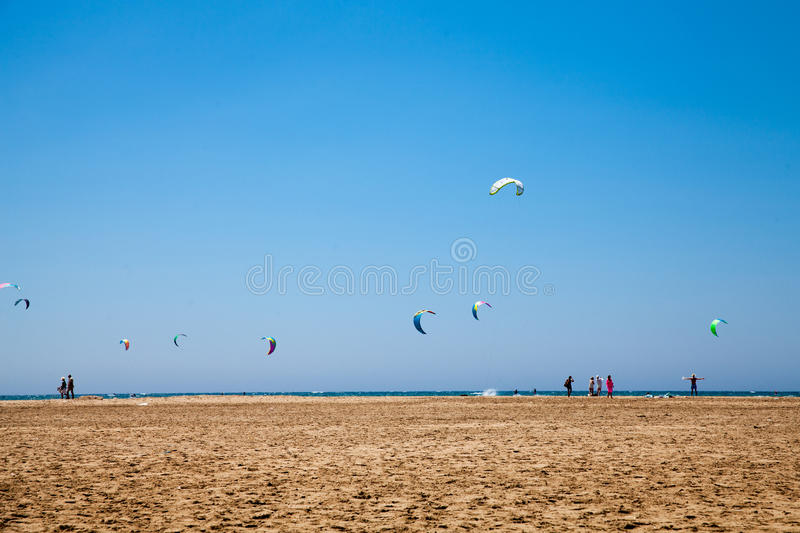 People practicing Kitesurfing. Beach on the Prasonisi. royalty free stock photography