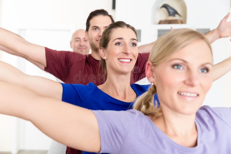 People practicing yoga lesson royalty free stock images