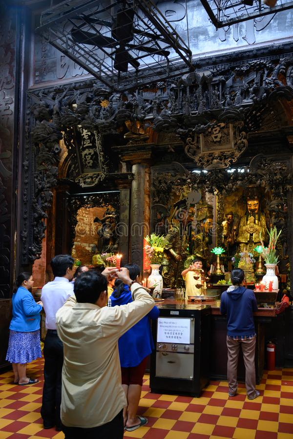 Asian people praying in Buddhist and Taoist Temple Jade Emperor Pagoda, Ho Chi Minh City, Vietnam. royalty free stock photo